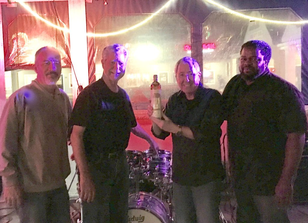Gary, JW, Bill and Ronnie pose with a bottle of Cat Daddy Carolina Moonshine brought to them by pal Rob Bryant. Thanks Rob!